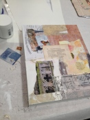First layer of medium, vintage papers and images, and gesso